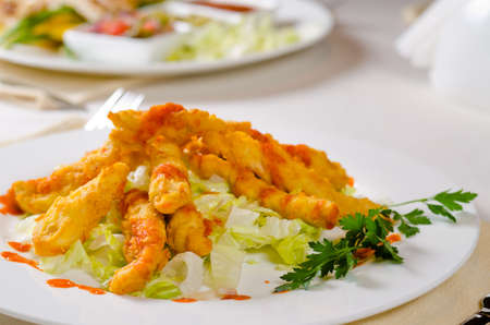 mouth watering: Close up Appetizing Main Course with Herbs on White Round Plate Served on Table.