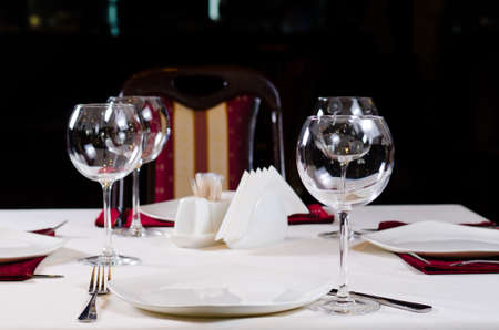 Table In Fancy Restaurant Set For Dinner With Wine Glasses Stock - Fancy restaurant table