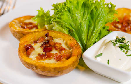 skins: Close Up of Potato Skins with Cheese and Bacon Appetizer with Dipping Sauce