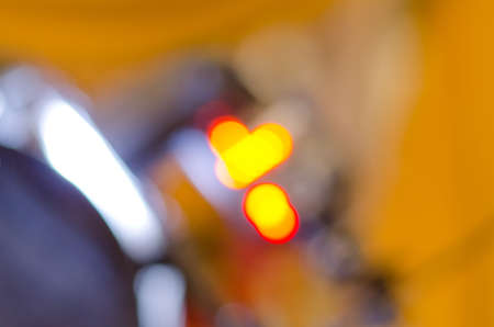 incertitude: Blurred abstract background with blurry yellow and neon electric lights
