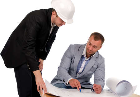 proposed: Young Male Designers Discussing the Proposed Project Design on Blueprint. Isolated on White Background. Stock Photo
