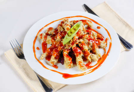 main course: Appetizing Main Course on White Plate Served on Table with Utensils on Sides. Ready to Eat Food,