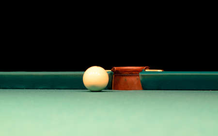 pool hall: Close up White Pool Ball on Billiard Table Near the Hole at the Edge Stock Photo