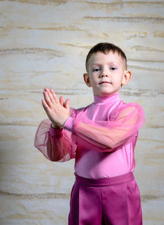 expressionless: Waist Up Portrait of Young Boy Wearing Pink Shorts and Shirt Posing with Together, Traditional European Male Dancer Wearing Dance Costume in Studio