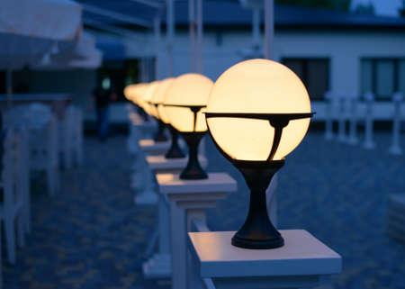 Row of Patio Lights Illuminating Soft Light Outdoors at Dusk Standard-Bild