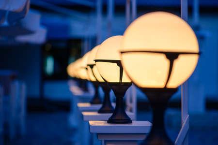 Row of Patio Lights Illuminating Soft Light Outdoors at Dusk 写真素材