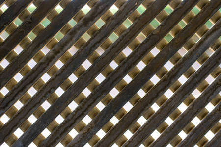 criss: Wooden trellis background texture in a geometric diamond pattern, full frame close up view