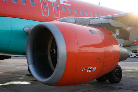 jetliner: Close up side view of the engine on a jetliner aircraft in a concept of transport, vacations and travel