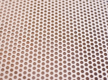 full of holes: Background texture of a mesh grid with holes in a repeat uniform pattern viewed at an oblique receding angle, full frame