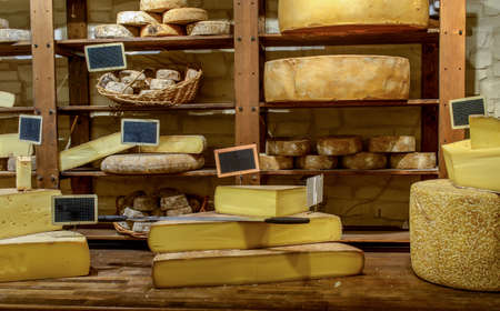 matured: Shop selling various handmade cheeses views of a few pieces of cutting the cheese ready for sale