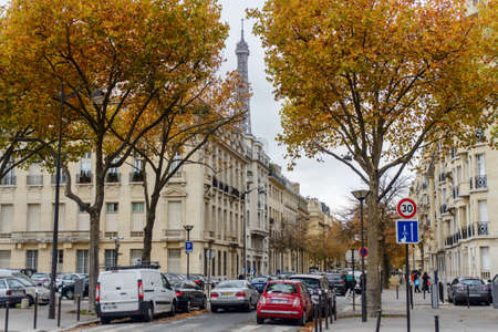 town homes: France, Paris 28 October 2015:Autumn in Paris , town homes among yellow trees in the background Eiffel tower