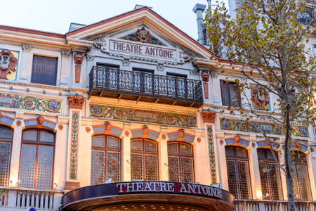 low angle views: France, Paris 01 November 2015:The facade of the Theater ANTOINE with a balcony amongst autumn trees