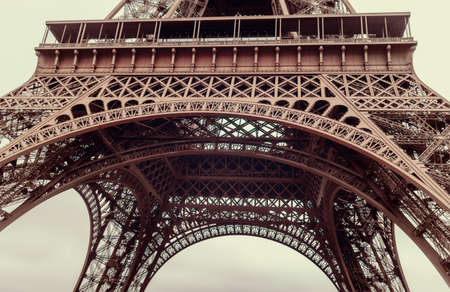 disappears: Low angle view of the Eiffel Tower, Paris, France looking up to the top as it disappears into the mist