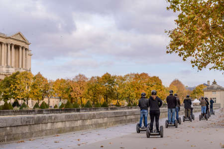 segway: Tour groups of tourists on the streets of Paris in the autumn of Segway Stock Photo