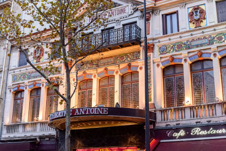 arts culture and entertainment: France, Paris 01 November 2015:The facade of the Theater ANTOINE with a balcony amongst autumn trees