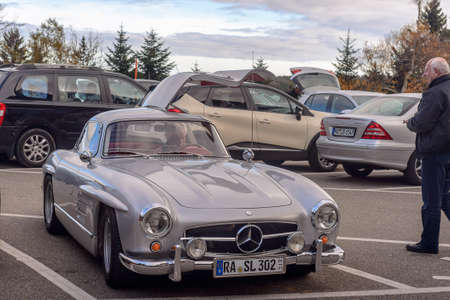 Germany, Baden-Baden - 05 November 2015: Legendary Gullwing Mercedes 300 SL sportcars to a road parking Editorial