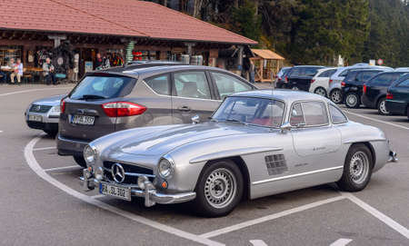 olden day: Germany, Baden-Baden - 05 November 2015: Legendary Gullwing Mercedes 300 SL sportcars to a road parking Editorial