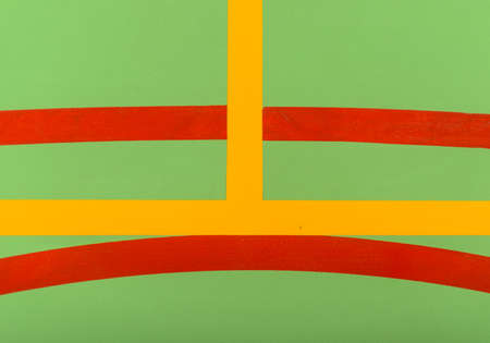 multipurpose: Colorful red, yellow and white markings on a green indoor sports court in an abstract background pattern ad texture