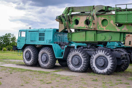 flatbed truck: Large heavy duty industrial trucks with set of eight wheels and missle carrier trailer in camouflage color Editorial
