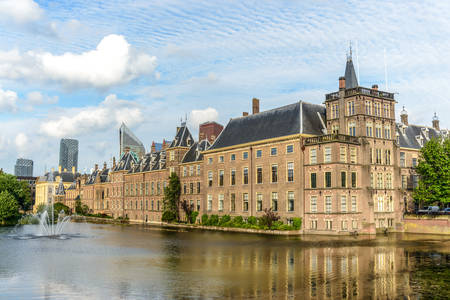 Hague, Netherlands - 28 July 2016:Magnificent chateau styled manor with river running alongside as clouds feather above