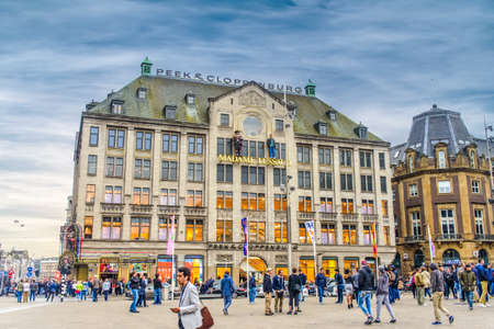 Amsterdam, The Netherlands - 28 July 2016:European city with wide plaza Madame Tussauds and old building as tourist and locals traverse it
