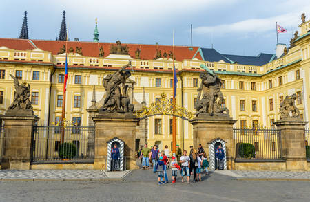 gated: Czech Republic, Prague -28 Jule 2016:Prague Castle, Families exit through lavish gated entryway adorned with large statues depicting dramatic scenes