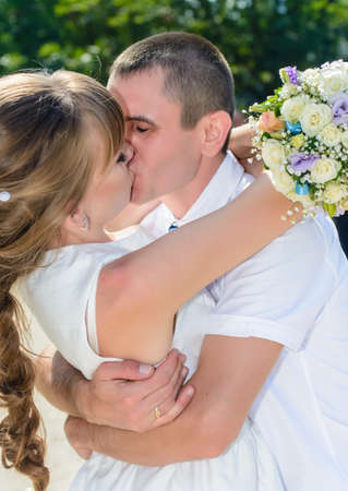Happy young couple of newlyweds deeply in love hugging each other with beaming smiles in a sentimental portrait