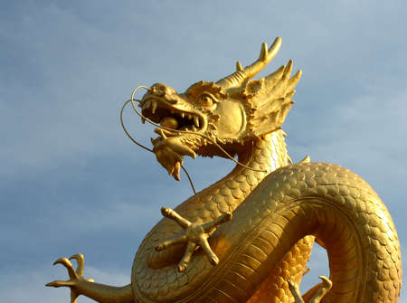 golden dragon statue and blue sky background photo