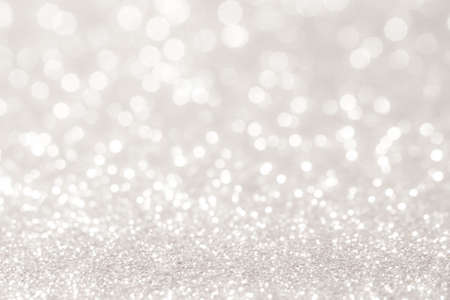 sparkle background: silver and white bokeh lights defocused. abstract background