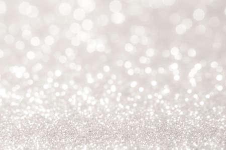 zilver en wit bokeh lichten defocused. abstracte achtergrond Stockfoto