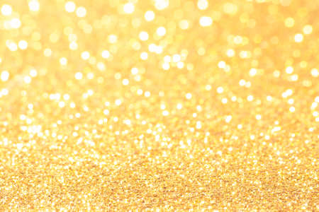 shimmering: gold and white bokeh lights defocused. abstract background