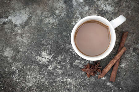 addictive drinking: Overhead view of a cup of coffee on grunge cement background with copyspace