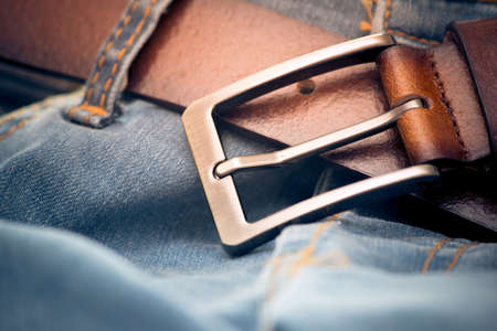 Close up blue jeans with brown leather belt selective focus.Instagram image style. Stock Photo