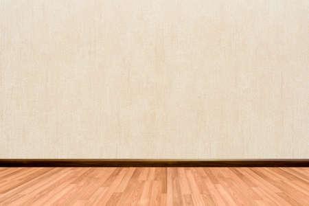beige background: Empty room background with wooden floor cream or beige wallpaper.