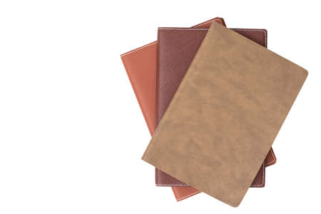 paper stack: Top view on the pile of books isolated on white background Stock Photo