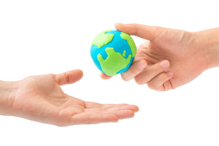 garden of eden: Human hand sending the earth into another hand isolated on white background. environment, Creation, Genesis, God and Adam, Responsibility, Mission concept.
