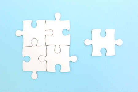 Group of puzzle and a puzzle piece. Teamwork concept. Think difference concept. Leadership concept. Stock Photo