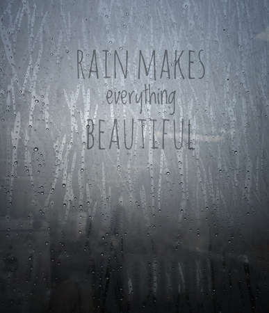 drop water: Rain drops on a window with wording Rain makes everything beautiful - Vintage effect style.