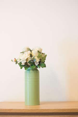 old photo: Plant on book shelf or desk.