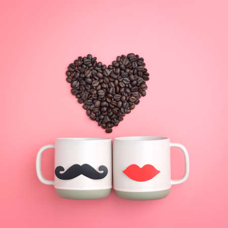 Heart made from coffee bean and paper fake lips and mustaches decoration on pink cup over pink background. Valentines day and wedding concept. Minimal style.