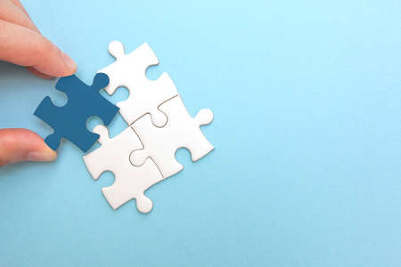 Creating or building own business concept. Puzzle piece mismatch, construction and development, build construct, idea and success, solution and growth, difference Stock Photo