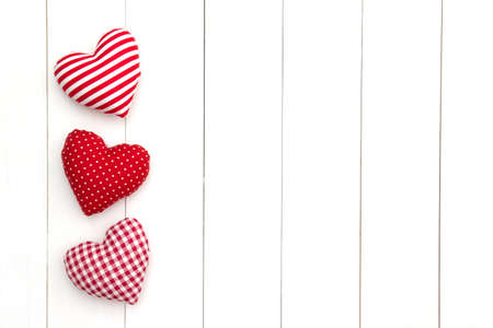 Pillow hearts shape on white wood planks with copy space. Happy Valentines day card mockup. Minimal style. Flat lay.