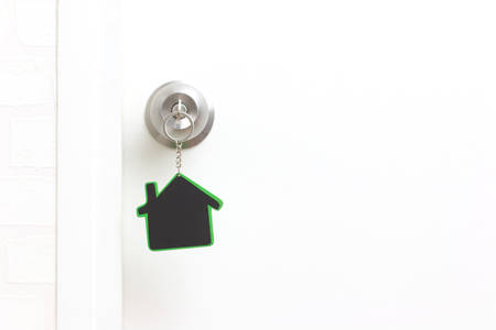 Symbol of the house and stick the key in the keyhole with copy space Stock Photo
