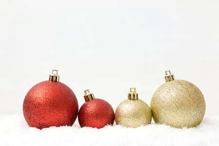 Christmas celebration and bauble decoration on snow isolated on white background with copy space.