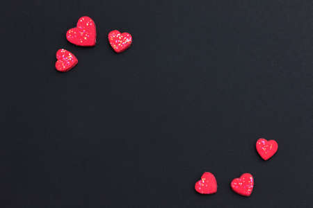 Red heart on black background with copy space for greeting card. Valentines day background concept. Flat lay. Minimal style 스톡 콘텐츠