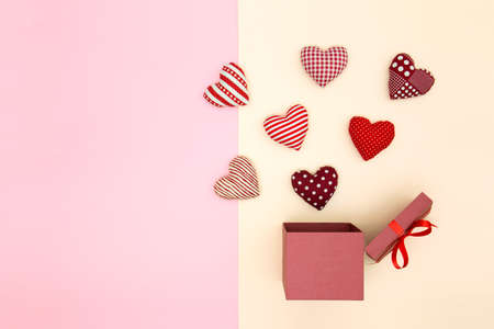 Pillow balloon hearts floating out of the gift box. Creative thinking about love and Valentines day. Minimal style. 스톡 콘텐츠