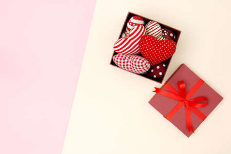 Flat lay of red pillows heart in gift box with copy space. Love and Valentine's day concept. Minimal style. 版權商用圖片