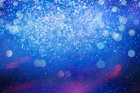 Glitter abstract background. Blue and Pink bokeh lights defocused.