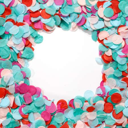Circle frame colorful confetti celebration on white background. Party background. Stock Photo