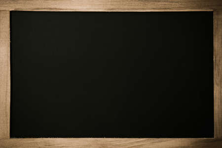 Blank chalkboard with wooden border.